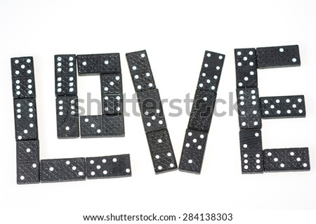 Word love made of wooden dominoes.