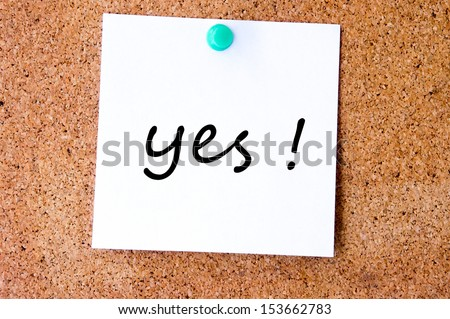 Word Yes placed from small letters on the cork board