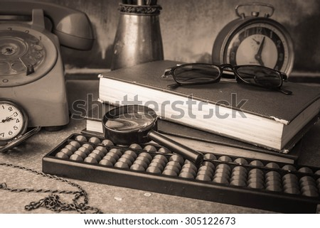 Work equipment placed on the table with black and white.