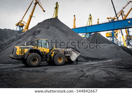 Work in port coal transshipment terminal.
