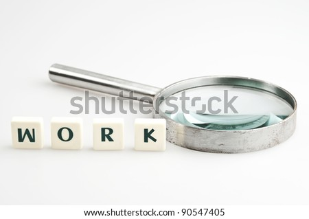 Work word and magnifying glass