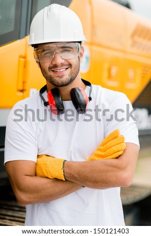 Worker at a construction site working with heavy machines