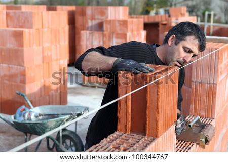 Worker building a wall