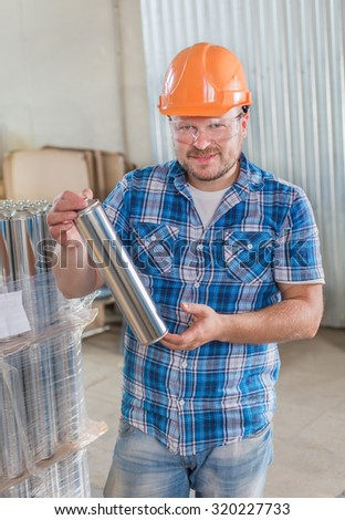 Worker in safety helmet at the storage