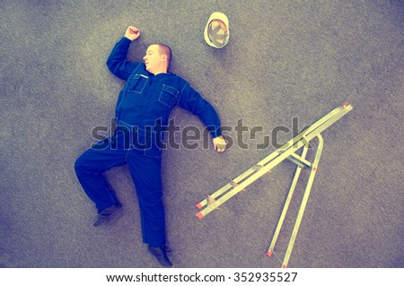 worker lying on the ground - accident at work