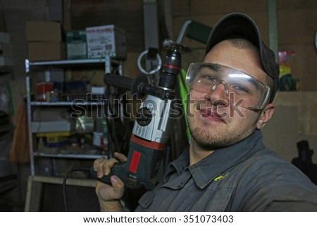 Worker makes selfie with the drill