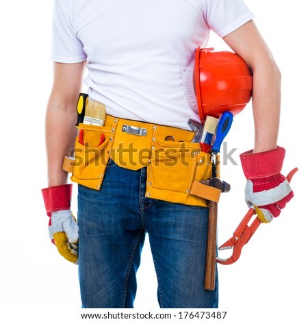 worker with tools belt holding an adjustable wrench