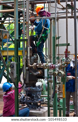 workers are repairing sundyne  pump in petrochemical plant