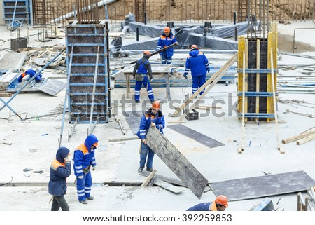 Workers at the construction site of the foundation of the building .Belarus, Minsk, October 22, 2014