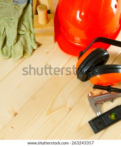 Working tools. Many working tools on a wooden background.