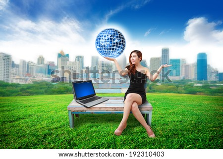 working woman and city background : Elements of this image furnished by NASA