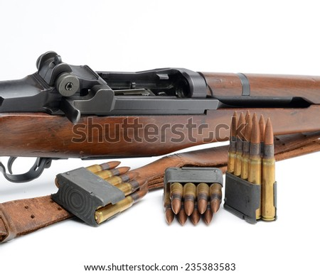 World War II M1 Garand Rifle, clips and 30-06 ammunition on white background.