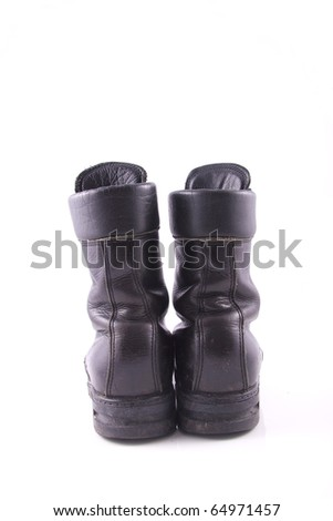 worn black army boot isolated on white