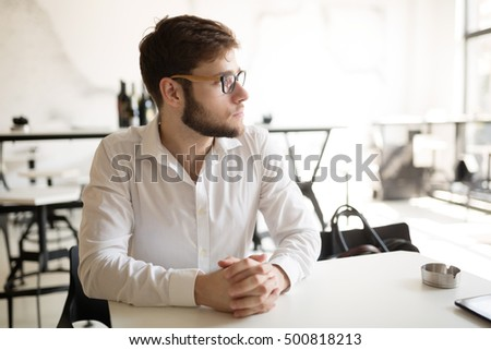 Worried businessman thinking on his coffee break