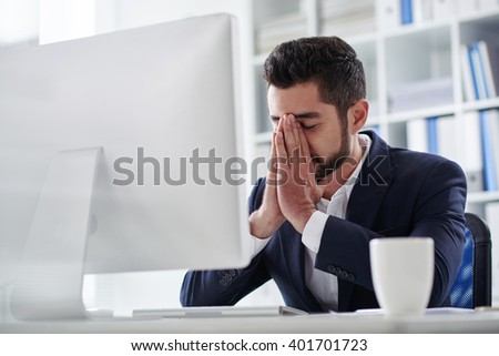 Worried or frustrated business executive in office