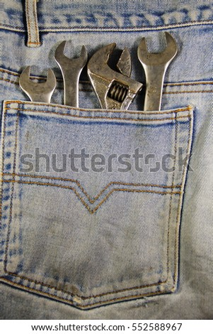 Wrench tools in the blue pocket jeans