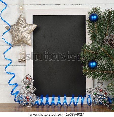 Writing board and Christmas decorations on a white background