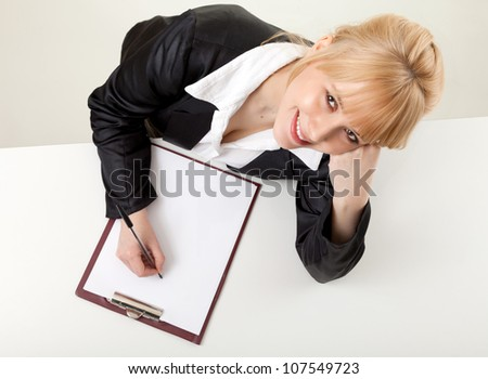 writing female student with clipboard, high angle view, white background