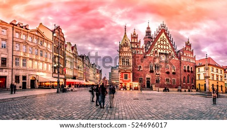 Wroclaw Market Square with Town Hall during sunset evening, Poland, Europe. HDR Photo with post processing effects