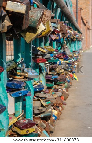 WROCLAW, POLAND - AUGUST 9: Padlocks on Tumski Bridge on August 9, 2015 in Wroclaw, Poland. The bridge is also called Lovers Bridge, because it is a tradition that lovers leave a padlock on it.