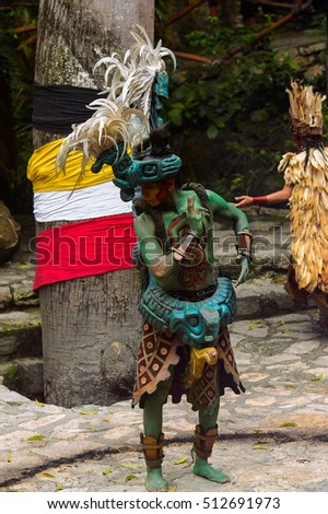 XCARET, MEXICO - NOV 8, 2015: Unidentified man wears a costume of a Maya indian and dances. The Mayan are a group of Indigenous people of Mesoamerica