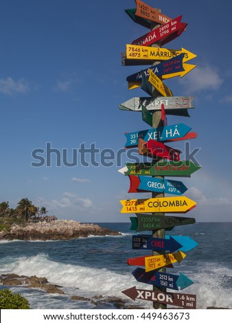 XCRET PARK, RIVIEA MAYA, MEXICO - March 31, 2016: Direction signpost with distance to many countries in Xcaret Park.