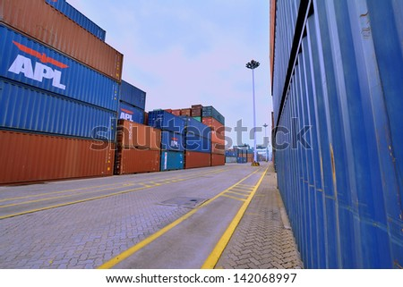XIAMEN - APRIL 21: Container goods yard in harbor of Xiamen, Fujian, South of China in April 21, 2013. Xiamen is a developing harbor city located in South-East of China.