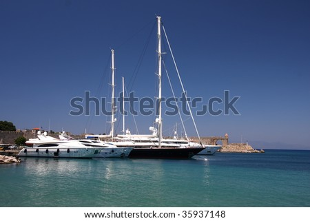 Yachts moored at a marina in Rhodes, Greece.
