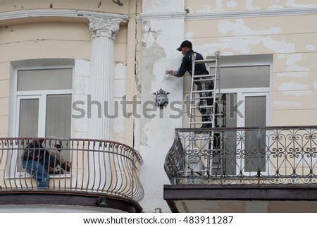 Yalta, Russia - April 27, 2016: workers do restoration of building exterior