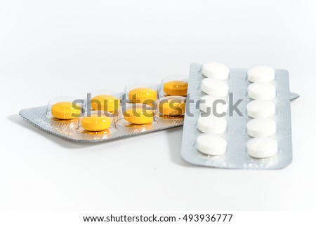 Yellow and white medicine in tablet package isolate in white background