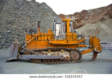 Yellow bulldozer. Copper quarry