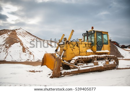 Yellow bulldozer in the quarry.