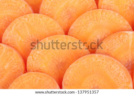 Yellow carrots, cut into pieces put together.