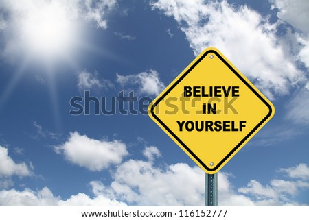 Yellow cautionary road sign Believe in yourself against a beautiful sky background