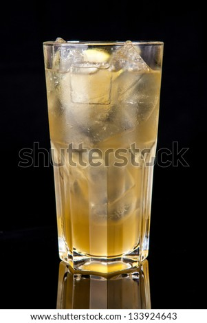 yellow cocktail isolated on black