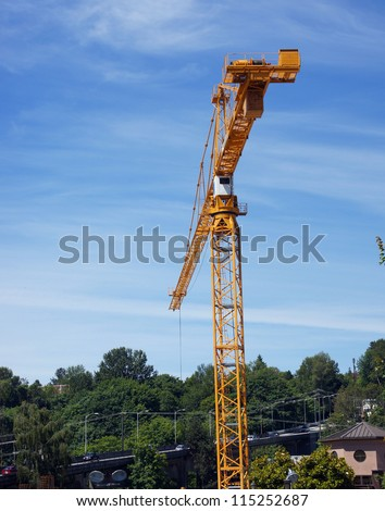 Yellow construction crane against blue sky  in Seattle
