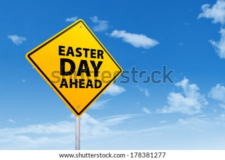 Yellow easter road sign on blue sky