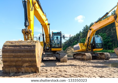 Yellow excavators on a construction site