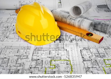 Yellow helmet, level and project drawings