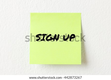 Yellow note paper with words Sign Up on the white wall