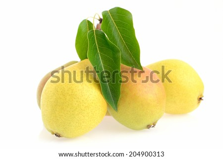 yellow pears with green leaves isolated on white