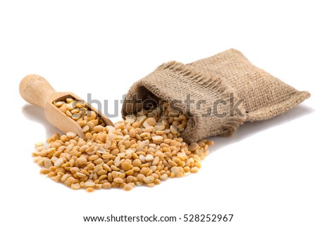 Yellow peas in a burlap with a shovel. Isolated