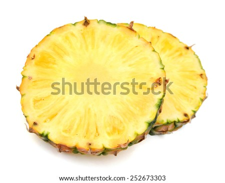 yellow pineapple slices on white background