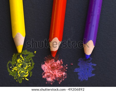 yellow, red and violet pencils