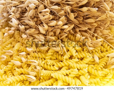 yellow spiral form pasta with oat grains
