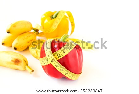 Yellow tape measure and sweet pepper on white background. Healthy lifestyle concept