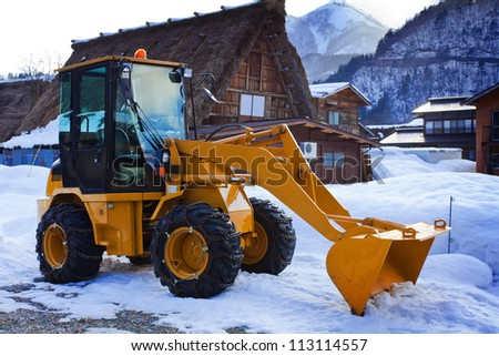 Yellow Tractor in Winter