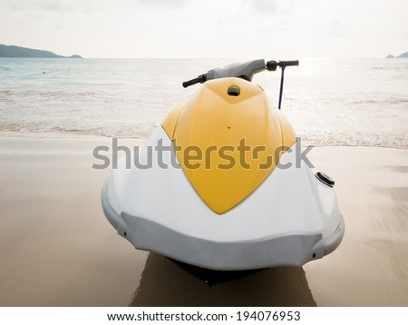 Yellow water scooter on the beach