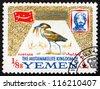 YEMEN - CIRCA 1965: A stamp printed in the Yemen shows Scopus Umbretta, Bird, Portrait of Imam Mohammed al-Badr, circa 1965 - stock photo