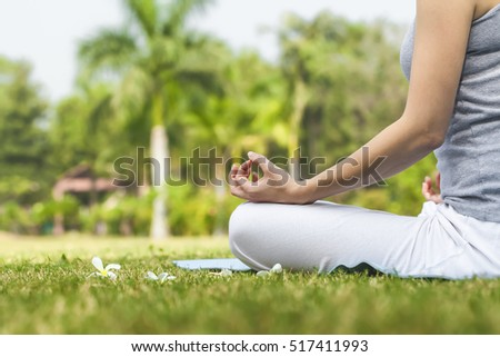 yoga girl in the summer park. meditation under a palm tree rainforest